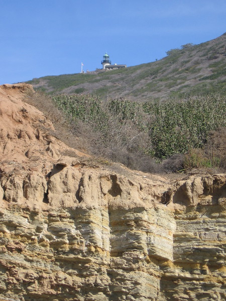 High above, atop Point Loma, I see the Old Point Loma Lighthouse, now a part of human history.