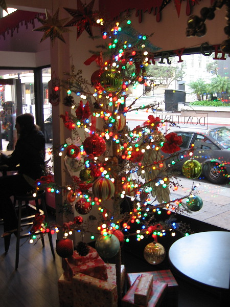 A bright, happy Christmas tree has appeared inside the Donut Bar.