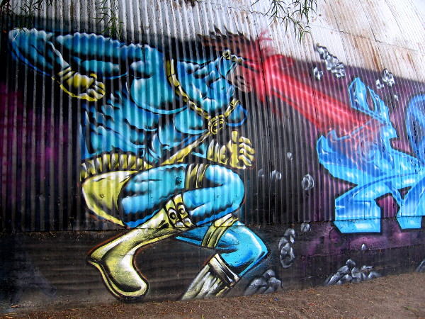 Cyclops in action street art in Logan Heights.