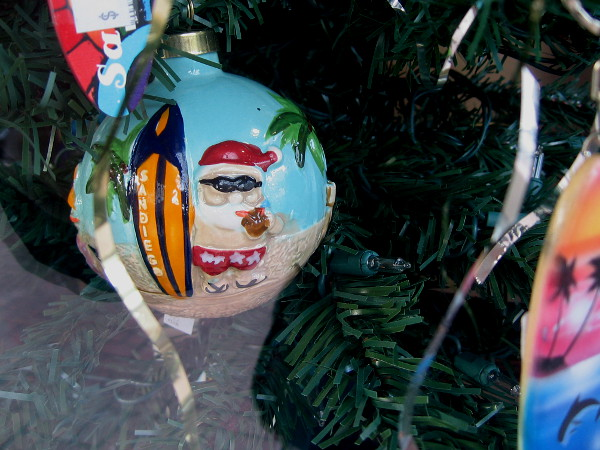 A funny surfing Santa ornament in the window of San Diego Trading Company!