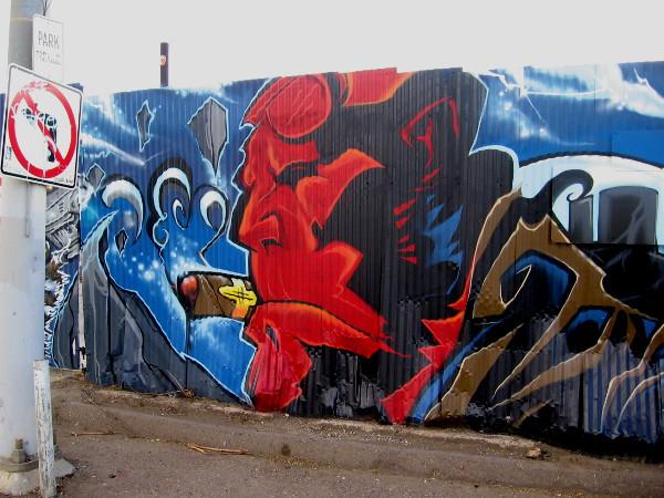 Hellboy street art by Fizix.