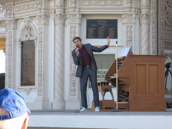 Raúl Prieto Ramírez, San Diego's Civic Organist, talks to the audience during the free Sunday concert at two o'clock.