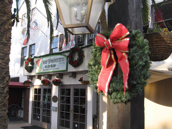 I discovered green and red wreaths at every turn as I walked about Old Town.