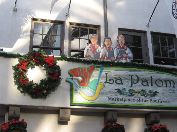 Looks like three Christmas carolers up on the balcony of La Paloma!