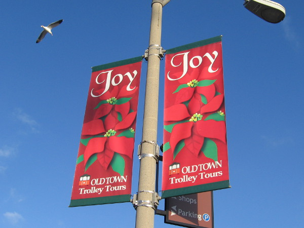 Old Town Trolley Tours wishes everyone Joy with their bright banners.