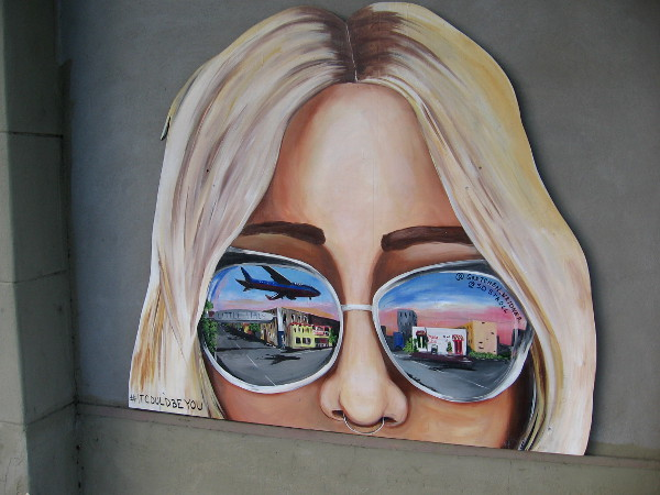 Cool sunglasses reflect images from Little Italy.