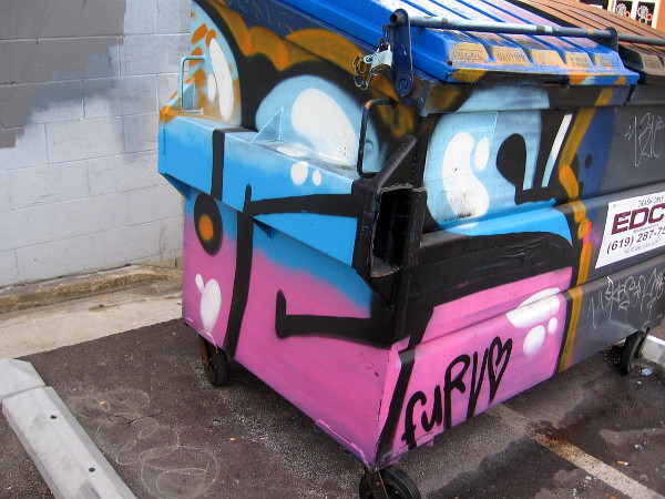 A half-painted dumpster.