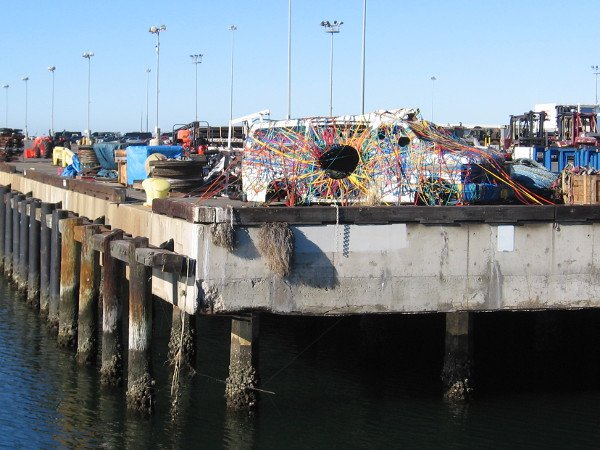 A van wrapped with many colors stands at one corner of the National City Marine Terminal on San Diego Bay!