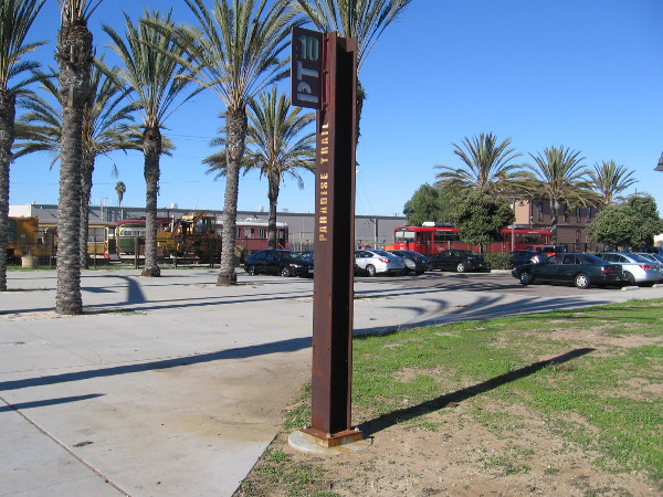 Paradise Trail marker PT10 rises near the National City Depot museum.