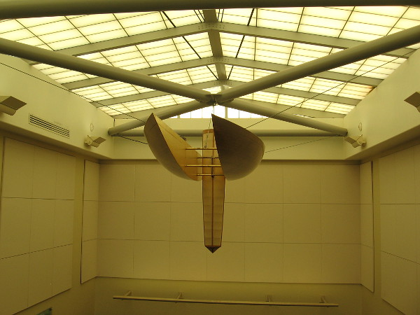 A wood and muslin chandelier is the keel of the abstract catamaran.