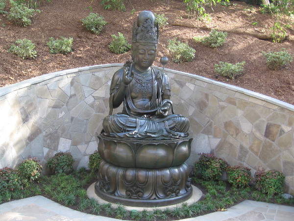 The large bronze Kannon Bosatsu represents the Japanese goddess of mercy.