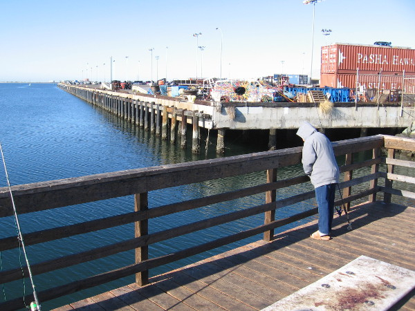 Fishing from the Pepper Park pier near public artwork commissioned by the Port of San Diego.