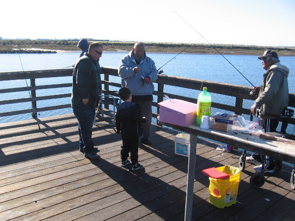 A kid got super excited when these guys caught a mackerel from the pier!