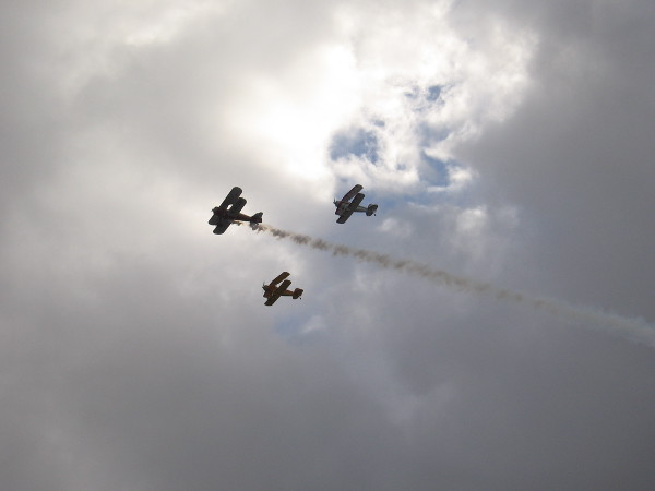 Before the Holiday Bowl Parade began, three cool old biplanes made a fly-by. Trailing smoke is a 1941 Boeing Stearman; the other two are Great Lakes.