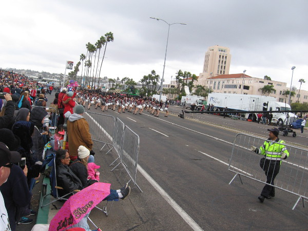 Barricades are moved as the Holiday Bowl Parade is ready to begin!