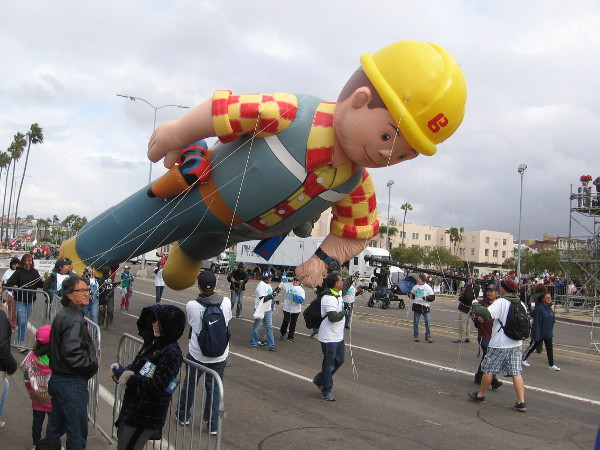 Bob the Builder has either lost his balance or the breezy weather had gotten the better of the balloon's handlers!