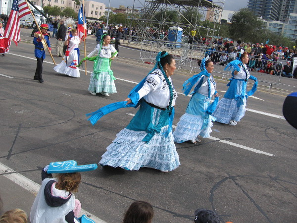 Herencia Hispana comes down Harbor Drive wearing elaborate dresses and folk costumes!