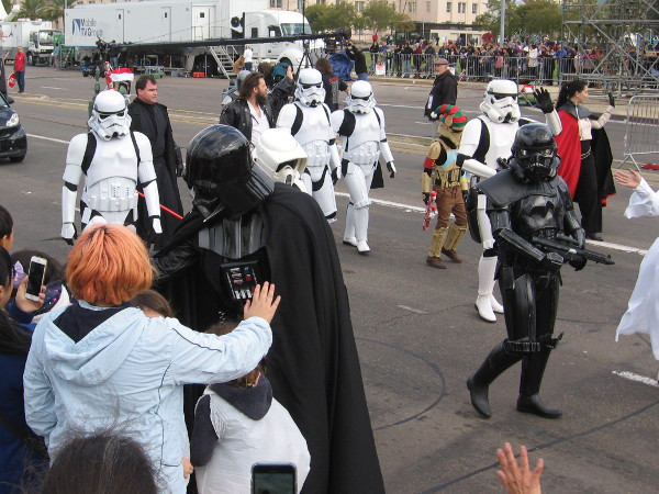 Darth Vader says hello to someone watching the cool parade.
