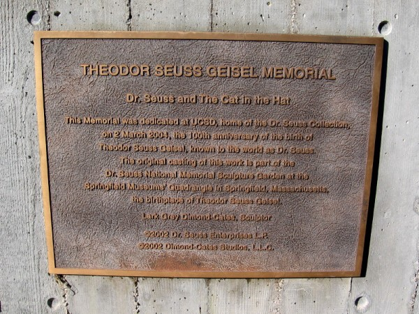 Plaque describes the Theodor Seuss Geisel Memorial at UC San Diego, home of the Dr. Seuss Collection. The memorial, by sculptor Lark Grey Dimond-Cates, was dedicated on 2 March 2004.