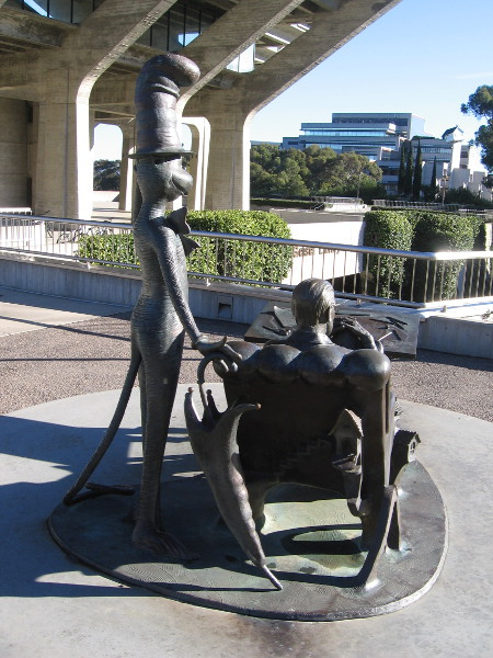 A bronze Cat in the Hat stands at the shoulder of Dr. Seuss.