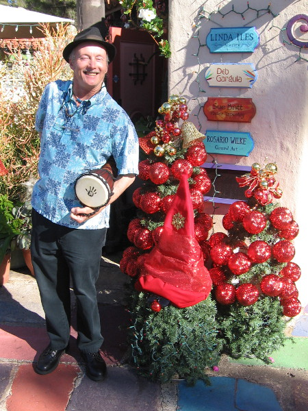 Jeff, the super cool Spanish Village Art Center historian, holds a drum and greets visitors with a huge smile!
