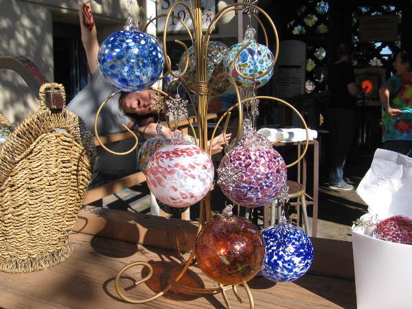 I was taking a photo of glass Christmas ornaments in Spanish Village when I got photobombed!