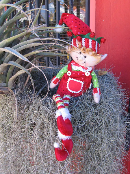 A happy elf was lurking near one of the Spanish Village artist studios.