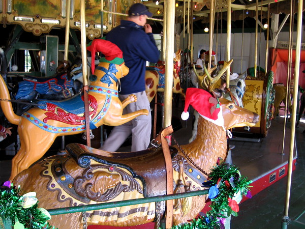 Some of the carved wooden animals of the Balboa Park Carousel were wearing elf and Santa hats.
