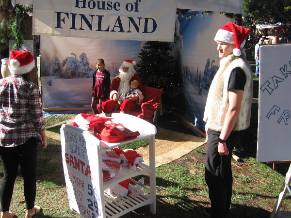 Santa, a guest of the House of Finland, was checking to see if children have been good at Balboa Park's International Cottages.