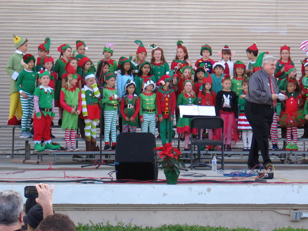 Second grade students from Dailard Elementary School fill Balboa Park with joyous song during 2018 Christmas on the Prado.