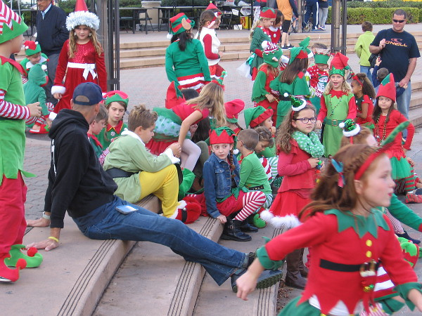 Dozens of happy elves would be first to perform on the Spreckels Organ Pavilion stage.