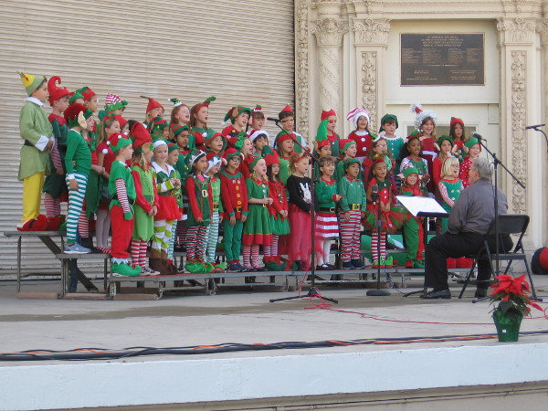 Young singers from Dailard Elementary School treat the crowd to fun holiday music.