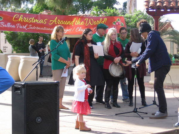 Members of the House of Ireland prepare to sing among the International Cottages during Christmas on the Prado in Balboa Park.