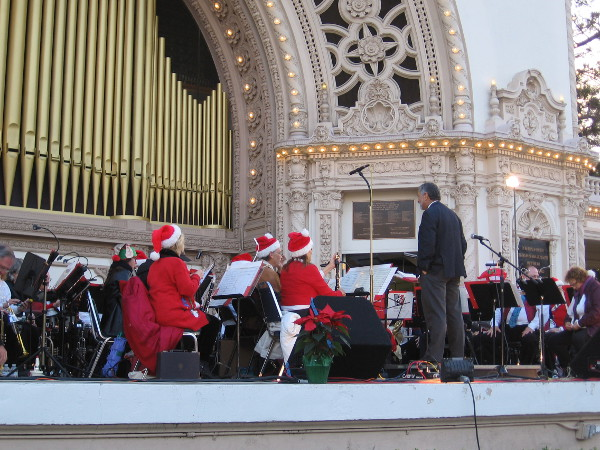 The Kearny Mesa Concert Band is almost ready to perform as the magical Spreckels Organ Pavilion lights come on.
