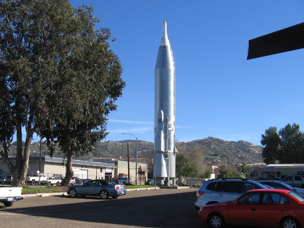 An imposing Atlas missile stands in one corner of the annex's parking lot!