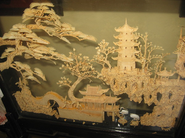 This small window-like scene at the House of China contains a fantastic, magical vision carved from cork!