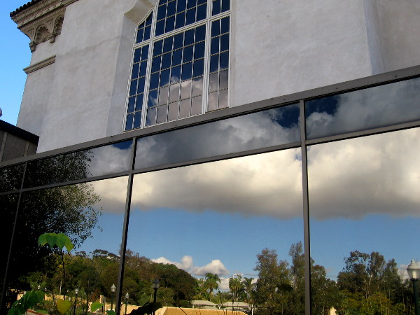 Reflections join magically together in two very different rear windows of the San Diego Museum of Art.