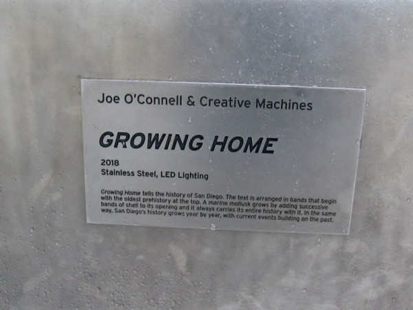 Growing Home, 2018, Joe O'Connell and Creative Machines, stainless steel and LED lighting. A city's history grows like the shell of a marine mollusk.