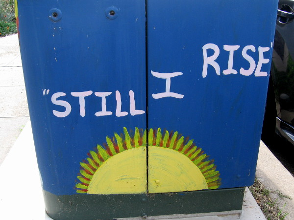 Inspiring street art reveals the sun's bright message . . . Still I rise.