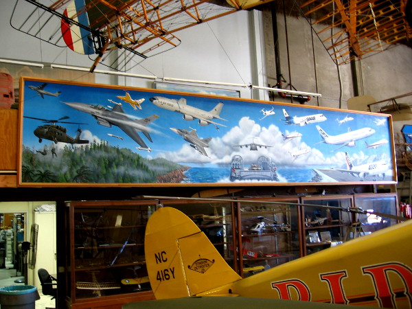 A long mural in the annex's hangar shows a variety of modern aircraft.