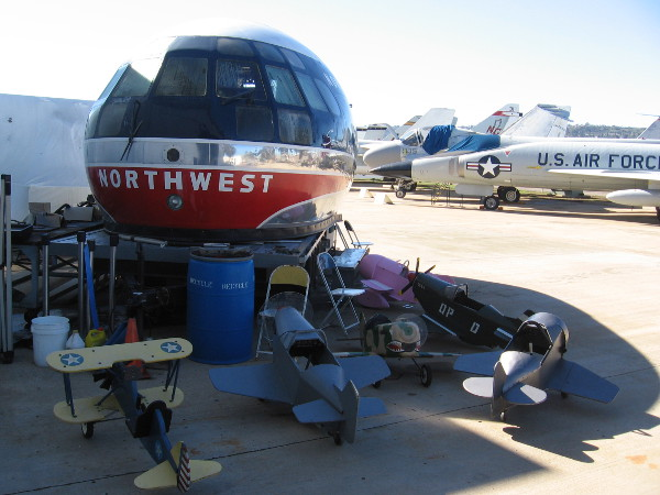 Outside the hangar doors is the nose of an old Northwest Stratocruiser that once flew to Honolulu.