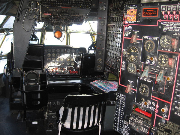 Hundreds of switches and gauges inside the amazing cockpit of a Boeing 377 Stratocruiser. One can sit in the pilot's seat and pretend to fly across the Pacific Ocean!