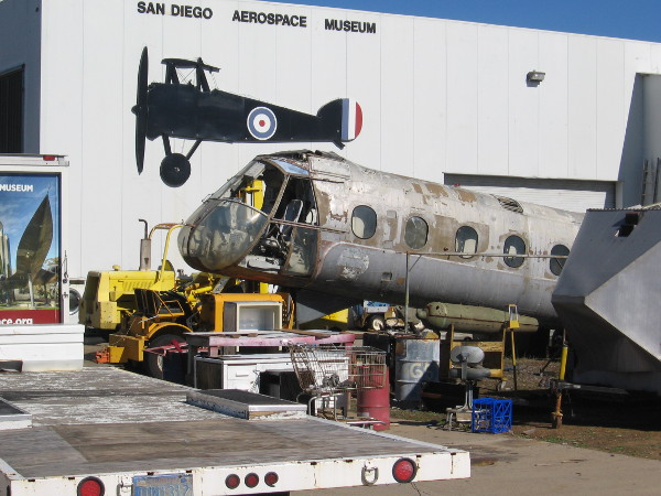 I learned there are several restoration projects now underway at the museum annex at Gillespie Field. I believe this is an old Piasecki H-21 helicopter.