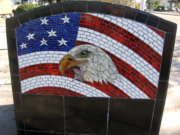 American eagle and flag mosaic art on rear of the POW/MIA Empty Chair is by the Rainforest Art Project.