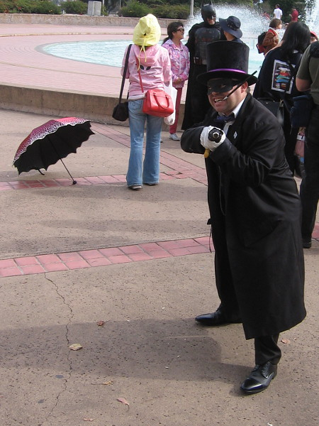 Batman! The Penguin is coming after me with one of his sinister umbrellas! Help!
