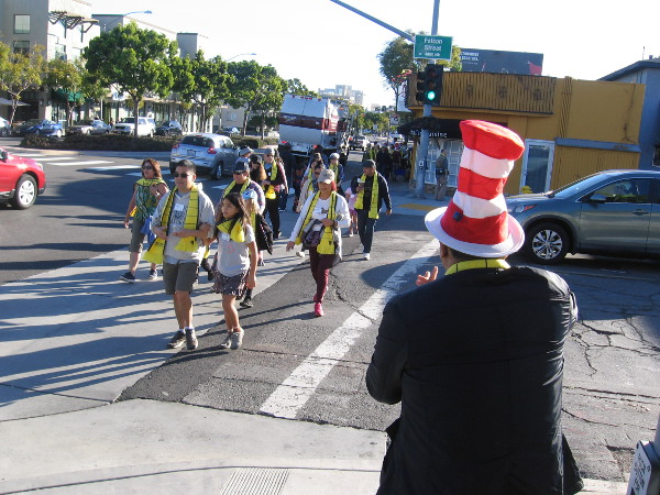 Those who will participate in the historic Book Pass, wearing yellow scarves, fan out along seven blocks of West Washington Street in Mission Hills.