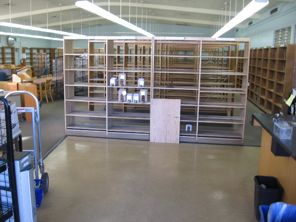 Empty shelves are all that's left in the old Mission Hill Library.