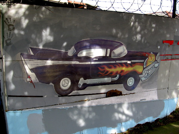 A cool car painted on a fence along Commercial Street in Logan Heights.