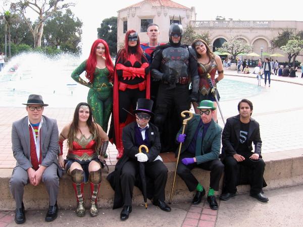 The JLA poses in Balboa Park. Members of San Diego's Science Fiction Coalition enjoy cosplay as Mera, Batwoman, Superman, Batman, Wonder Woman, Clark Kent, another Wonder Woman, Penguin, Riddler and Superboy!