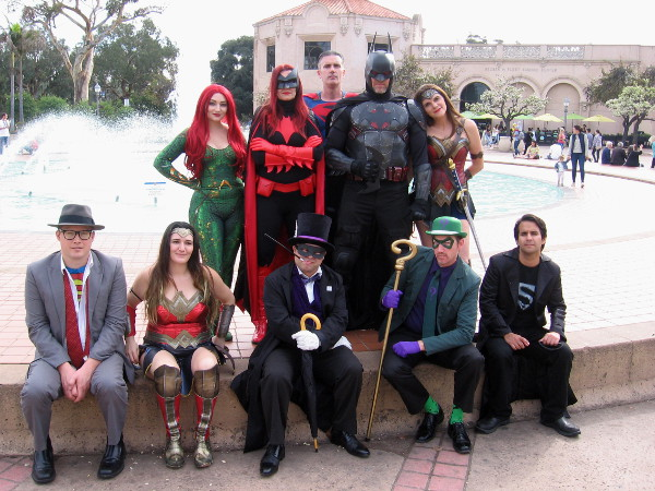 The JLA poses in Balboa Park. Members of San Diego's Science Fiction Coalition enjoy cosplay as Mera, Batwoman, Superman, Batman, Wonder Woman, Clark Kent, another Wonder Woman, Penguin, Riddler and Superboy!